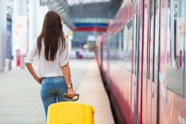 train-travel-girl-with-luggage